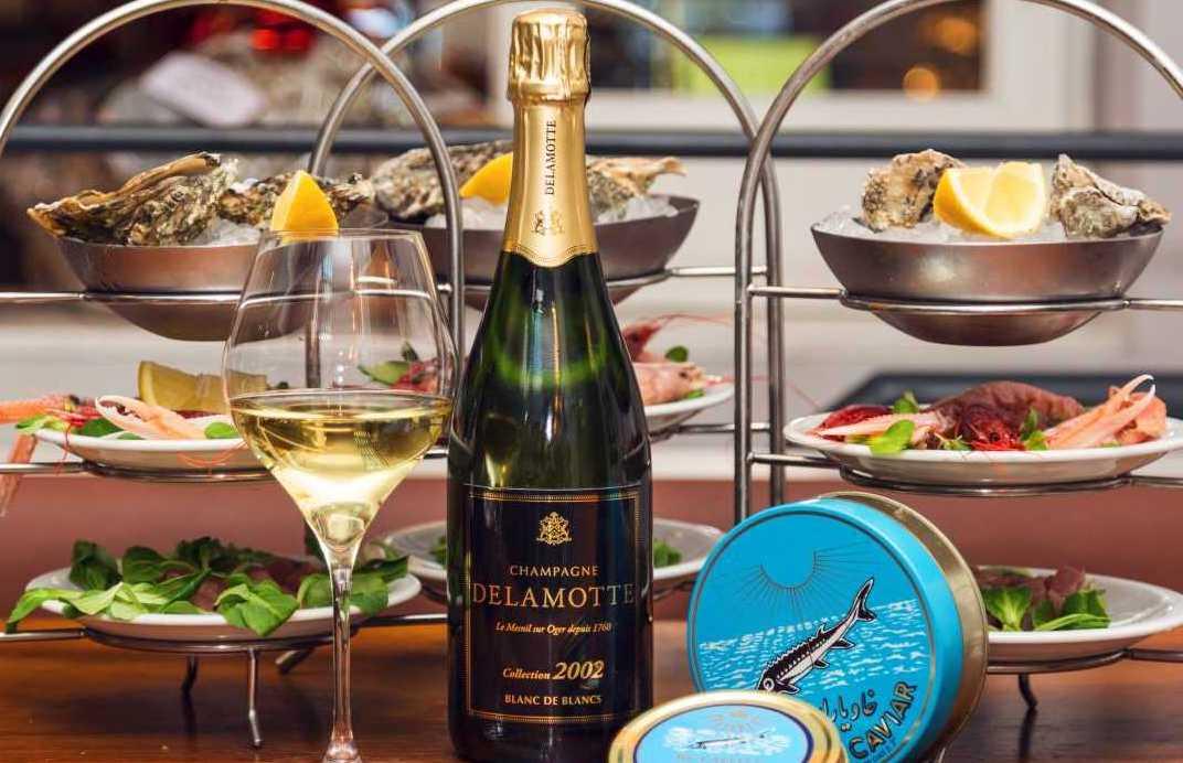 champagne delamotte esposto da ercoli con pesce crudo e caviale